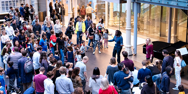 Children and adults take part in a workshop in the Paul Hamlyn Hall